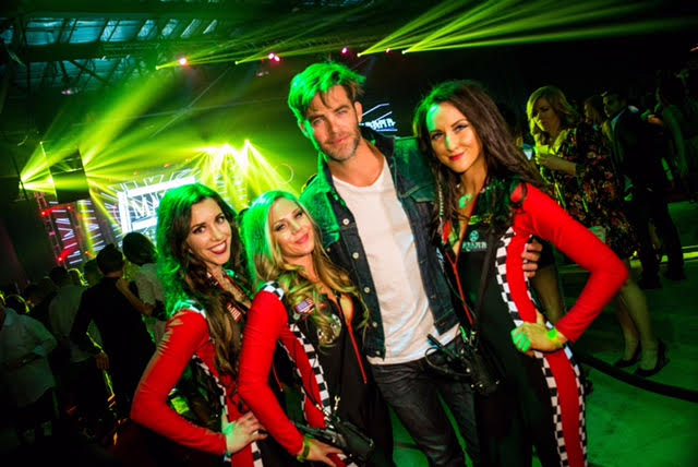 Chris Pines was all smiles as he snapped photos with the Budweiser ladies at The 2016 MAXIM Party during Indy 500 weekend, with energizing mixers by Red Bull, Life Support recovery shots, and Steak & Shake burgers and fries, and specialty sips by Hangar 1 Vodka and Maestro Dobel Tequila, in celebration of the 100th Running of the Indy 500, in Indianapolis, IN, on Friday, May 27th, 2016.  / Photo Credit: Karma International