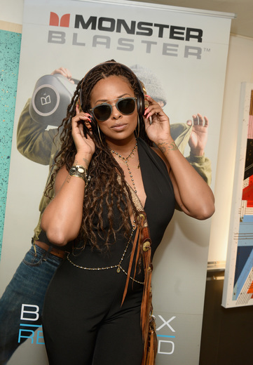 Model/TV Personality Eva Marcielle Checking out Monster Headphones. Photo Credit: Getty Images for BET