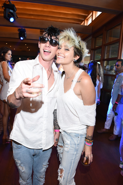 "Paris Jackson and her boyfriend cuddled up for a photo at the Booty Bellows ""Red, White and Bootsy"" bash hosted by John Terzian and The h.wood Group in honor of the 4th of July yesterday at Nobu Malibu in Malibu, CA. Photo Credit: Vivien Best/Getty Images"