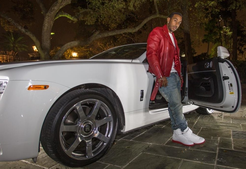 Ludacris rolled up in style at Haute Living Magazine's  pre-Super Bowl dinner celebrating music executive  Chaka Zulu 's birthday at a private estate in Houston. The magazine partnered with  Hublot, LOUIS XIII  and  Rolls-Royce.  Photo Credit: Thaddaeus McAdams  |  ExclusiveAccess.net