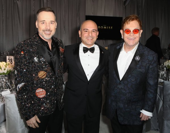 WEST HOLLYWOOD, CA - FEBRUARY 26: (L-R) Host Sir Elton John, Eric Esrailian and David Furnish attend the 25th Annual Elton John AIDS Foundation's Academy Awards Viewing Party at The City of West Hollywood Park on February 26, 2017 in West Hollywood, California. (Photo by Ari Perilstein/Getty Images for EJAF)