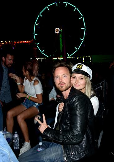 Aaron Paul and wife Lauren Parsekian keeping cozy at The Levi's Brand Presents NEON CARNIVAL with Tequila Don Julio on April 15, 2017 in Thermal, California. Photo Credit: Michael Bezjian/WireImage