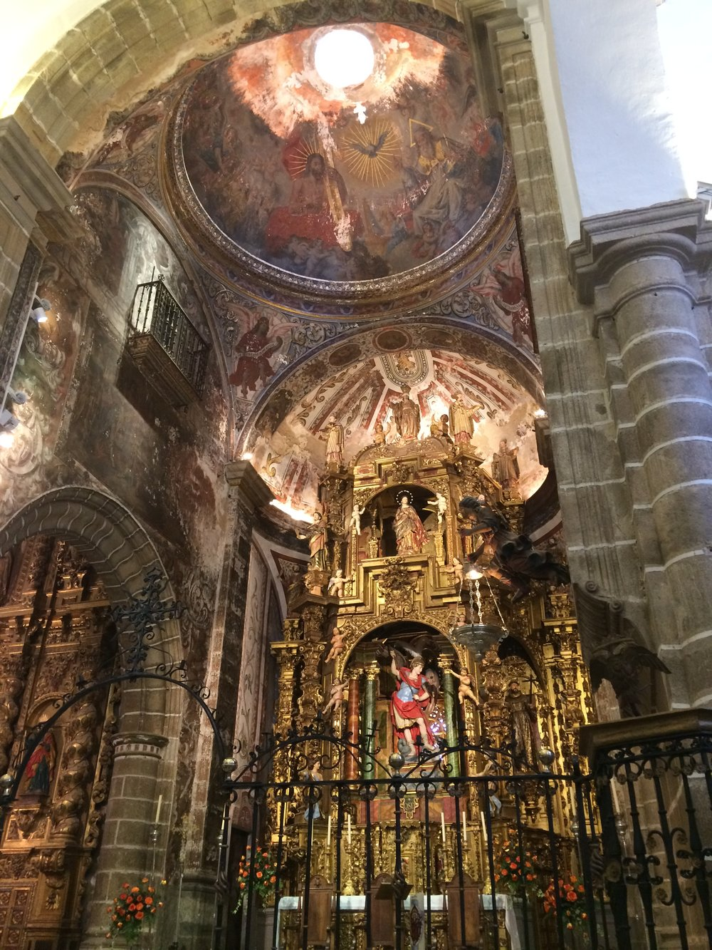 Catholicism is The Largest Religion in Spain! Traveling Through the Region You Will See Many Different Contextual Styles Such as Spanish Baroque. Brass, High Vaulted Ceilings, Preserved Items, as Well As Chandeliers Are a Few of The Beautiful Pieces That Are Seen!  Mass Still Occurs Regularly in Extremadura! Photo Credit: Courtesy of Extremadura Tourism