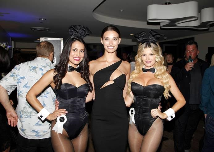 Cover model Dana Taylor (center) with the Playboy bunnies at the Talent Resources Sports Party hosted by Martell Cognac at Playboy Headquarters on July 11, 2017. Photo Credit: Tibrina Hobson/Getty Images for Talent Resources Sports.