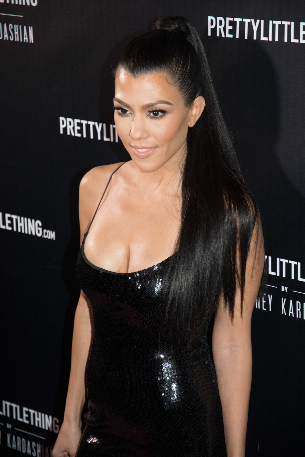 Kourt rocked a dress and strappy heels from her new collection. Photo Credit: Pretty Little Thing PrettyLittleThing by Kourtney Kardashian Black Strappy Sequin Bodycon Dress $45 PrettyLittleThing by Kourtney Kardashian Black Pointed Patent Stiletto Heels $55
