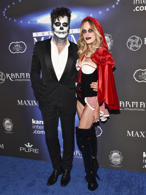 New parents and DWTS couple Maksim Chmerkovskiy and Peta Murgatroyd were locked hand-in-hand at The 2017 MAXIM Halloween Party. Photo Credit: Getty Images