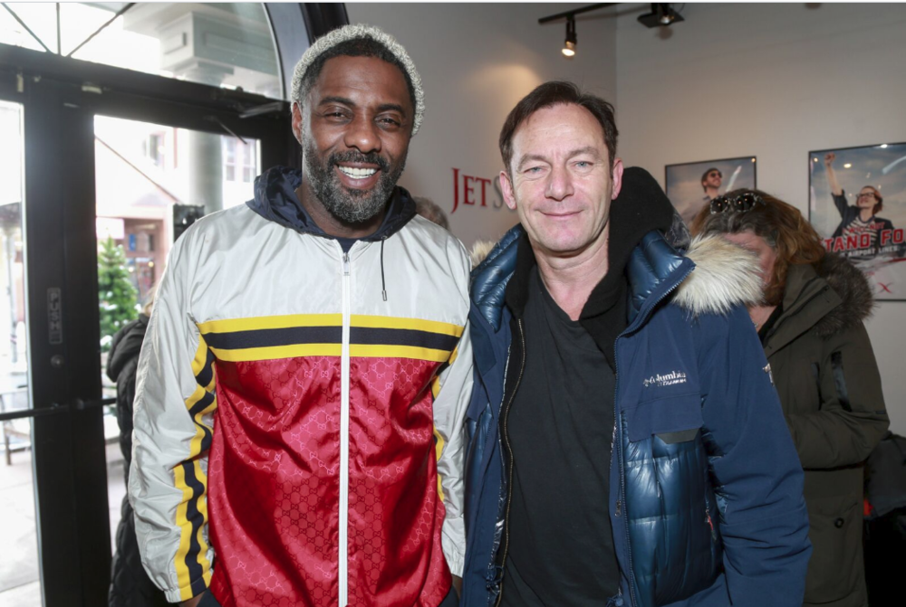 Idris Elba and Jason Isaacs pose for a quick photo at the Music Lodge hosted by influencer marketing program, IconicReach during the Sundance Film Festival on January 21. (Photo Credit: Miles Mortensen | AP Images for IconicReach)