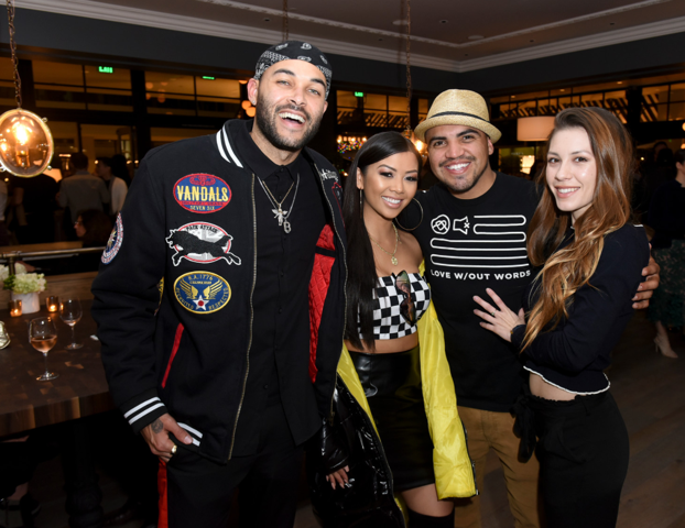 Don Benjamin, Lianne V, Victor Ortiz and a guest hugged each other out as they celebrated the official grand opening party of  The Henry  restaurant last night in West Hollywood, CA.  Photo Credit: Vivien Best