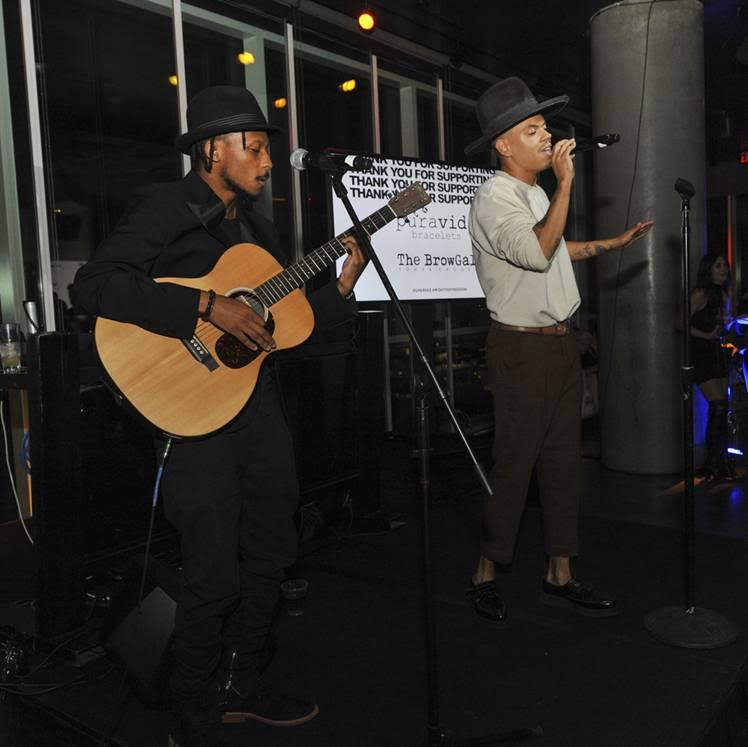 Palmer Reed and Evan Ross perform at the Unlikely Heroes Nights of Freedom LA with Tito's Handmade Vodka and BeatBox Beverages on June 21, 2018 in Hollywood, California.  (Photo by Michael Bezjian | Getty Images for Unlikely Heroes)
