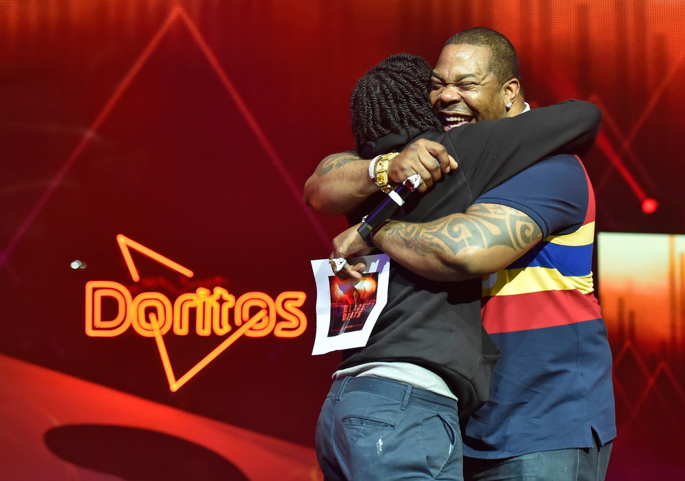 Busta Rhymes crowns Enoch Tolbert hip-hop's next star, the Doritos Blaze The Beat winner at the Life Is Beautiful pre-party. Photo Credit: Getty Images