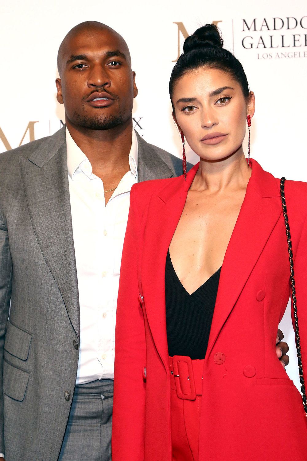 Larry  and  Nicole English  were picture perfect at  The VIP Opening of Maddox Gallery LA  featuring   its inaugural exhibition ' Best of British', where guests enjoyed speciality cocktails provided by  Guillotine Vodka  on   Thursday, October 11th in West Hollywood, CA. (Photo by Tommaso Bodi/Getty Images for Maddox Gallery)