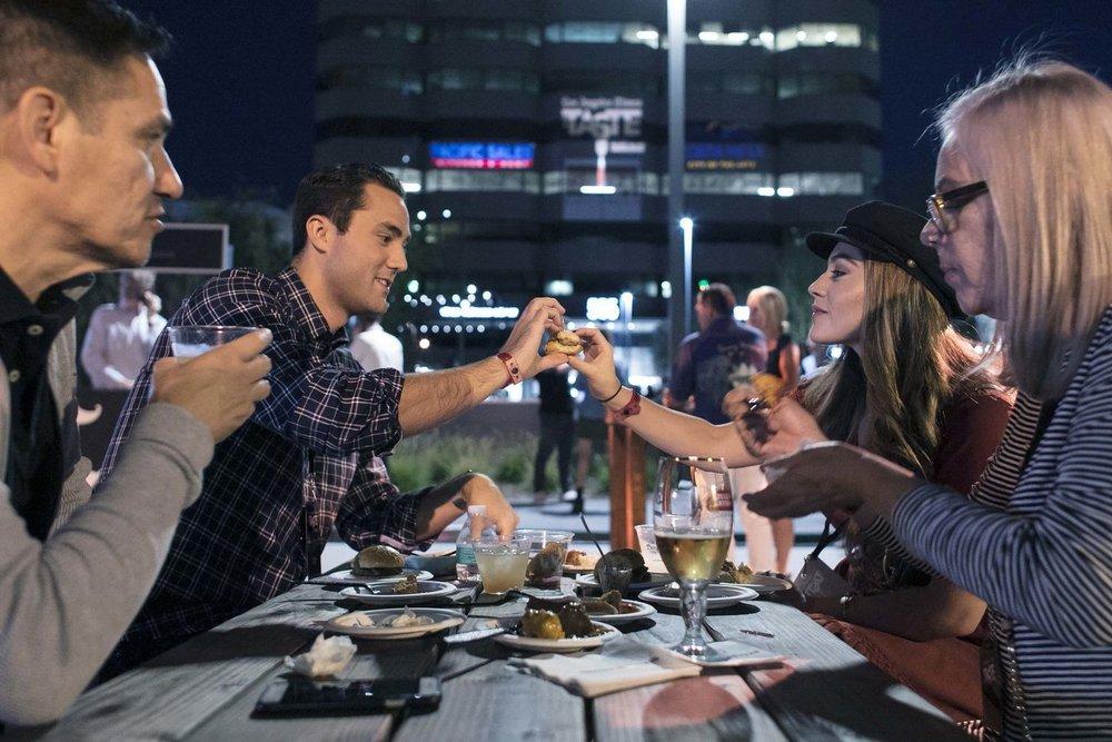 Alejandro Girron, left, Jonathan Schoeman, Alexa Girron and Teresa Girron sample the food and drinks during the second night of the L.A. Times' The Taste OC on Saturday. (Silvia Razgova / For The Times)