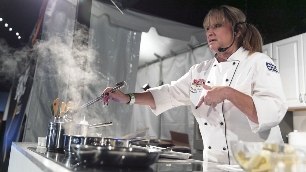 Filomena's Italian Kitchen and Market owner and chef Linda Johnsen prepares a Champagne chicken over white-wine risotto during her live demo. Photo Credit: Silvia Razgova / For The Times