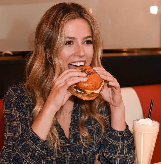 Kristina Schulman of the Bachelor dove into an Easy's burger and Roundtine Milkshake at the opening of Easy's Diner  Chelsea Kane attended the opening of Easy's Diner. Photo Credit: Tap Studios, Michael Bezjian
