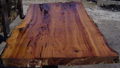 A beautiful example of a sinker cypress slab.  Look at that grain!