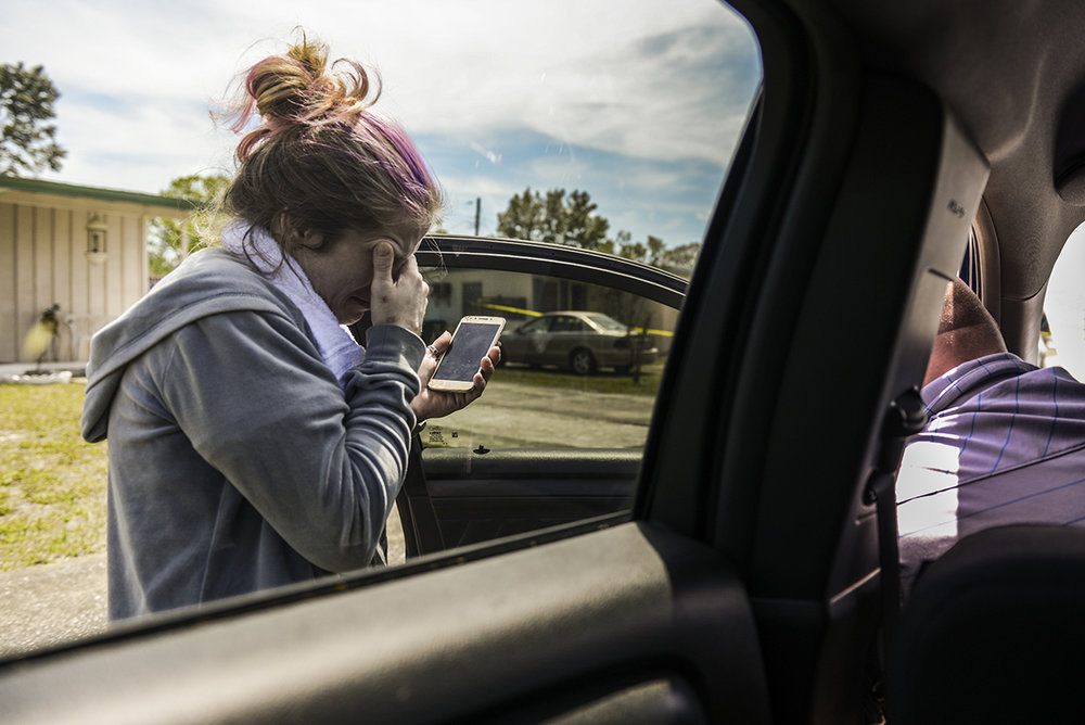 Mary Harden struggles to stay composed during a phone call in the presence of Shon McGuire, a Volusia County Sheriff's Office detective assigned to investigate drug-facilitated deaths. Miller visited Harden with her son the previous evening and appeared to be high on heroin, McGuire said. Deltona, Friday, March 30, 2018.