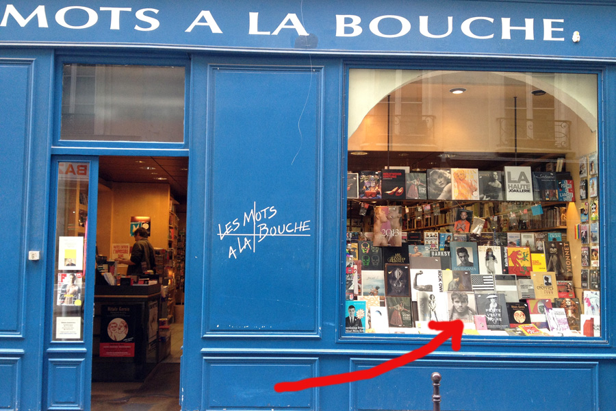 "The shop window of the famous Paris book store Les Mots a Bouche with ""Outback Bushmen"" displayed"