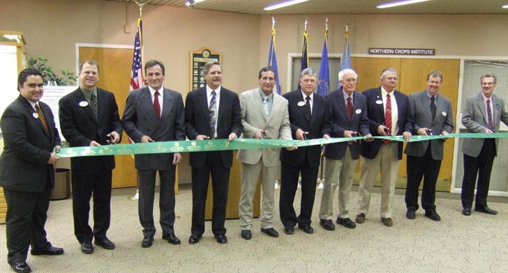 Cutting the Ribbon! Left to right: Mehmet Tulbek, NCI Technical Director; Brian Sorenson, NCI Director; Rene Steiner, Buhler Inc.; North Dakota Governor John Hoeven; North Dakota Commissioner of Agriculture Doug Goehring; David Clough, North Dakota Wheat Commission; Arlo Skari, Montana Wheat and Barley Committee; Laird Larson, South Dakota Wheat Commission; Mark Jossund, Minnesota Wheat Research and Promotion Council; and John Crabtree, NCI Assistant Director.