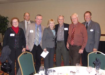 Left to right: Mrs. Lorraine Langseth; David Torgerson, Executive Director of Minnesota Wheat Research and Promotion Council; Bill Zurn, Minnesota Soybean Research and Promotion Council; Karolyn Zurn, Northern Crops Council; former Governor George Sinner; Senator Keith Langseth, Minnesota District 9; and Mark Jossund, Minnesota Wheat Research and Promotion Council.
