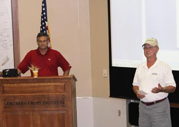 WQC Executive Director Ben Handcock (right), thanks the crop tour participants and sponsors of the tour during the wrap-up event at NCI. Dave Green (left), ADM, was moderator of the discussion.