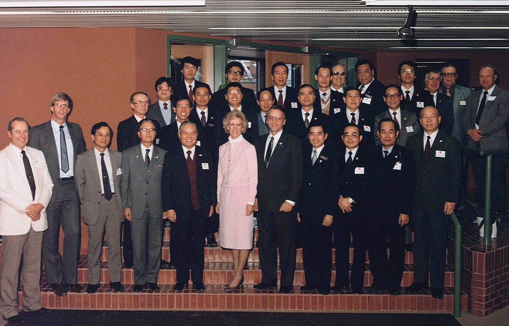 Former Governor George Sinner and His Wife Jane, stand on the front Stairs of the interior of the Northern Crops institute with taiwanese Buyers during the Taiwan Buying Mission on September 29, 1985.