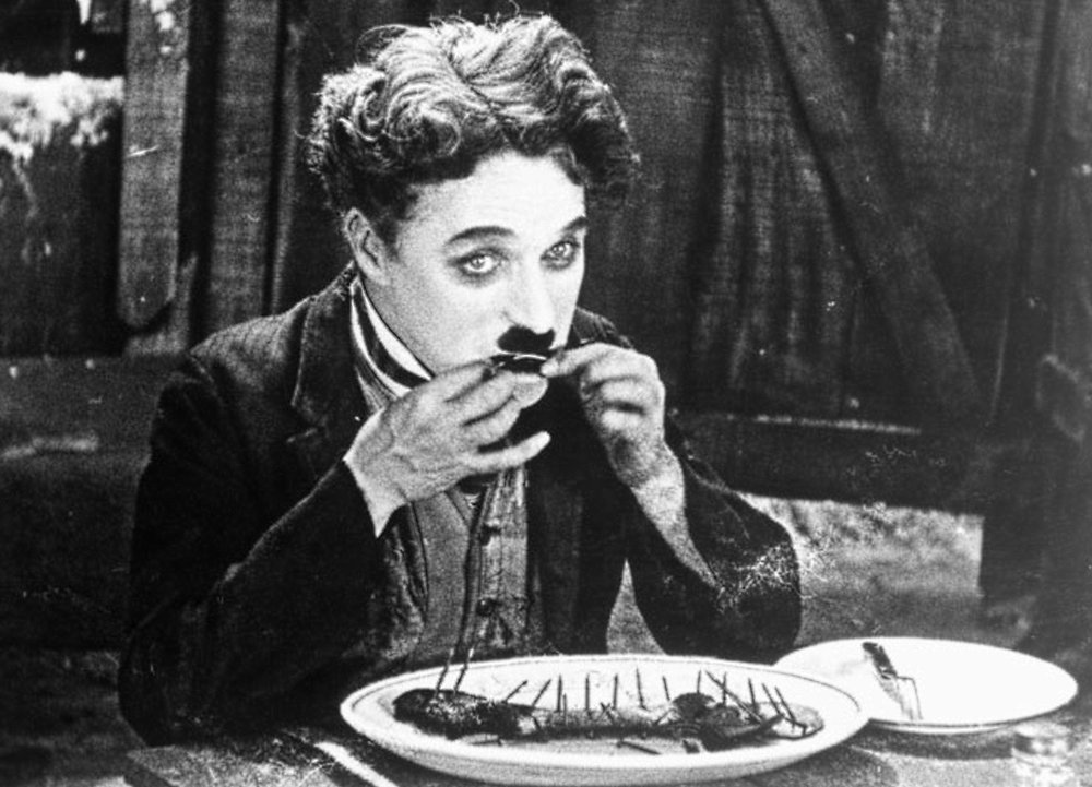 A 'silent' meal of sorts - Charlie Chaplin eats his boot in 'The Goldrush'