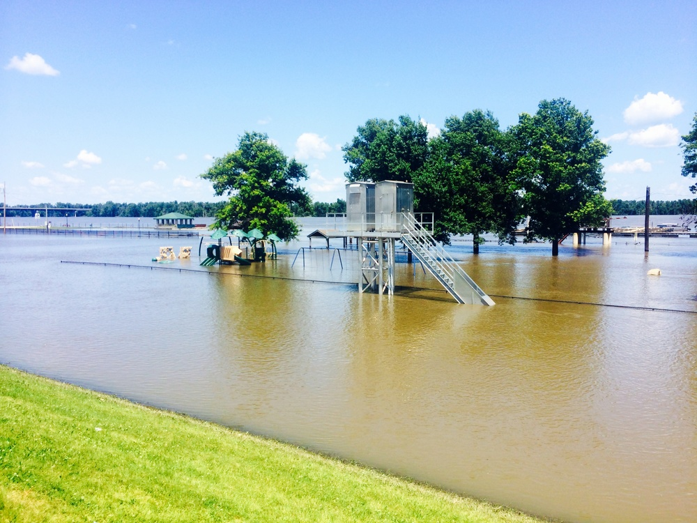 The Mississippi River has been flooded for the past several weeks, which made us take a different route than planned. You can see the iron fence and playground completely submerged!