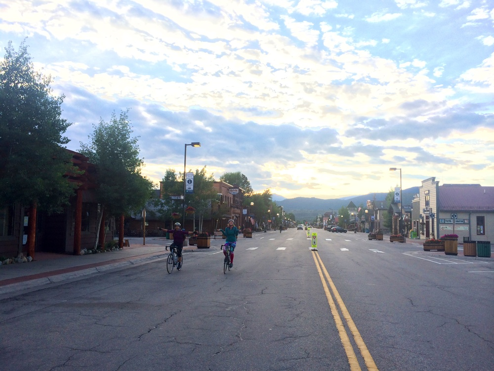 Our female leaders, May and Michelle, riding in the early morning through Frisco, CO, a big ski town