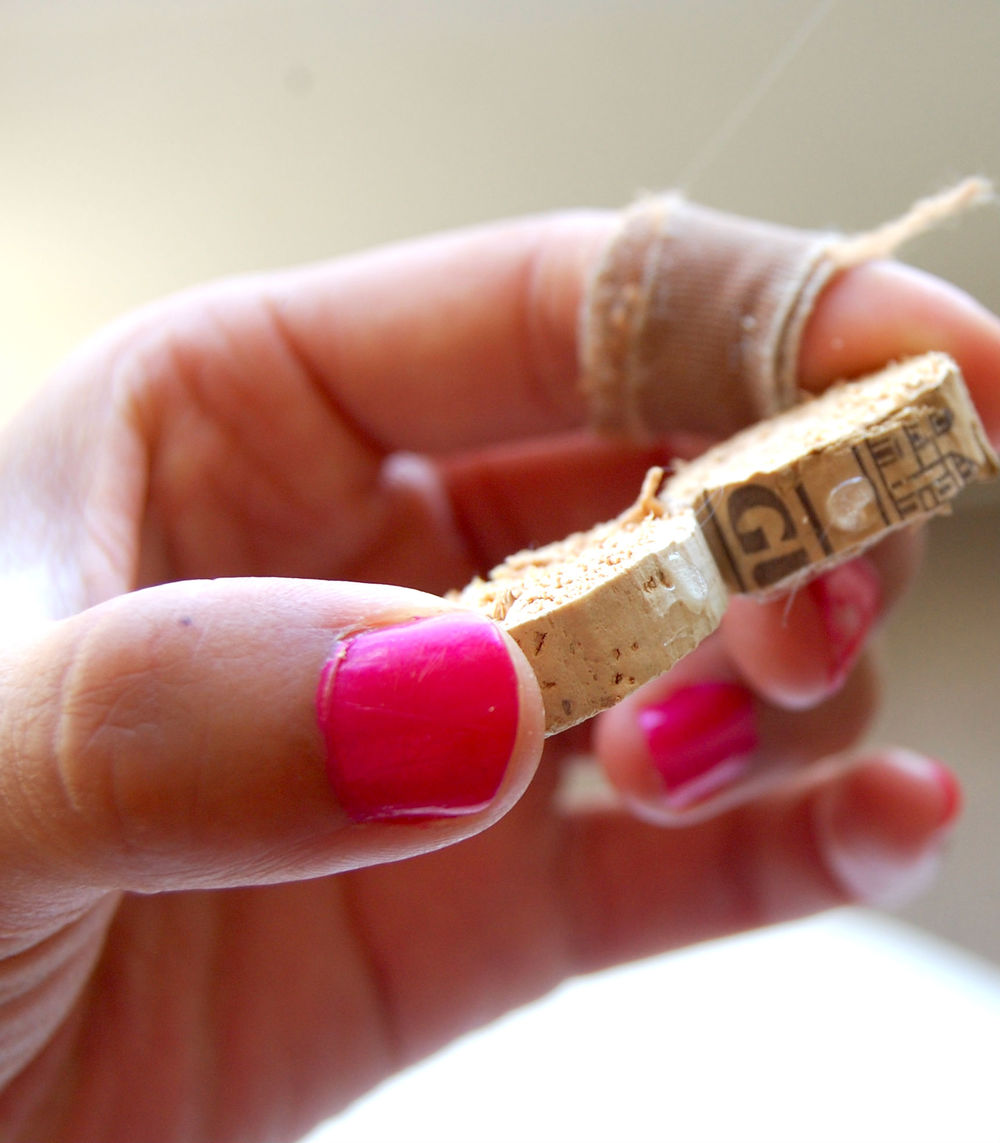 The two drops should be closer to the corner than to the middle of each cork, so that the new cork piece will touch it!
