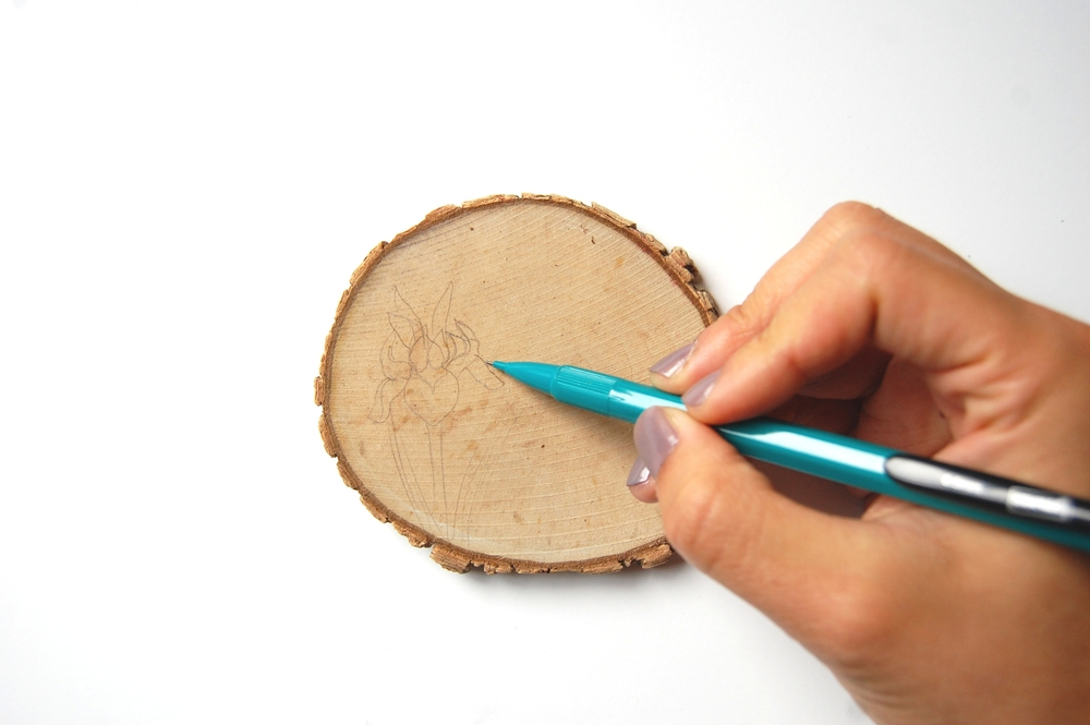 Sketch your pattern onto your wood slice