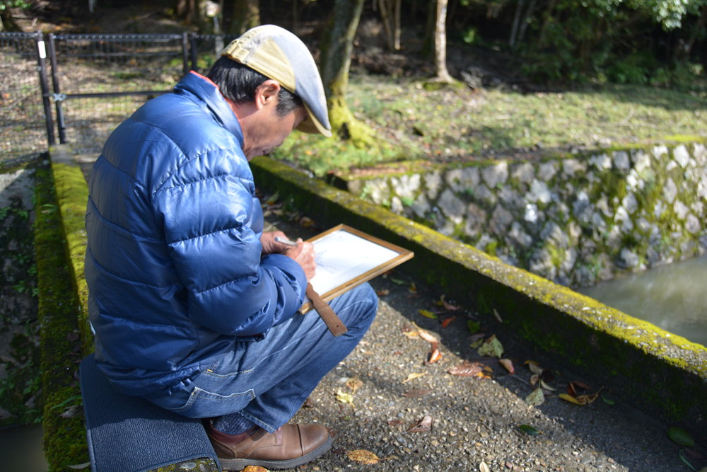 This artist was drawing on a small footbridge on the Philosopher's Path in Kyoto. He was sketching these incredibly detailed drawings with a fine pencil - I've never seen something so intricate. My photo of the print doesn't do the real thing justice!