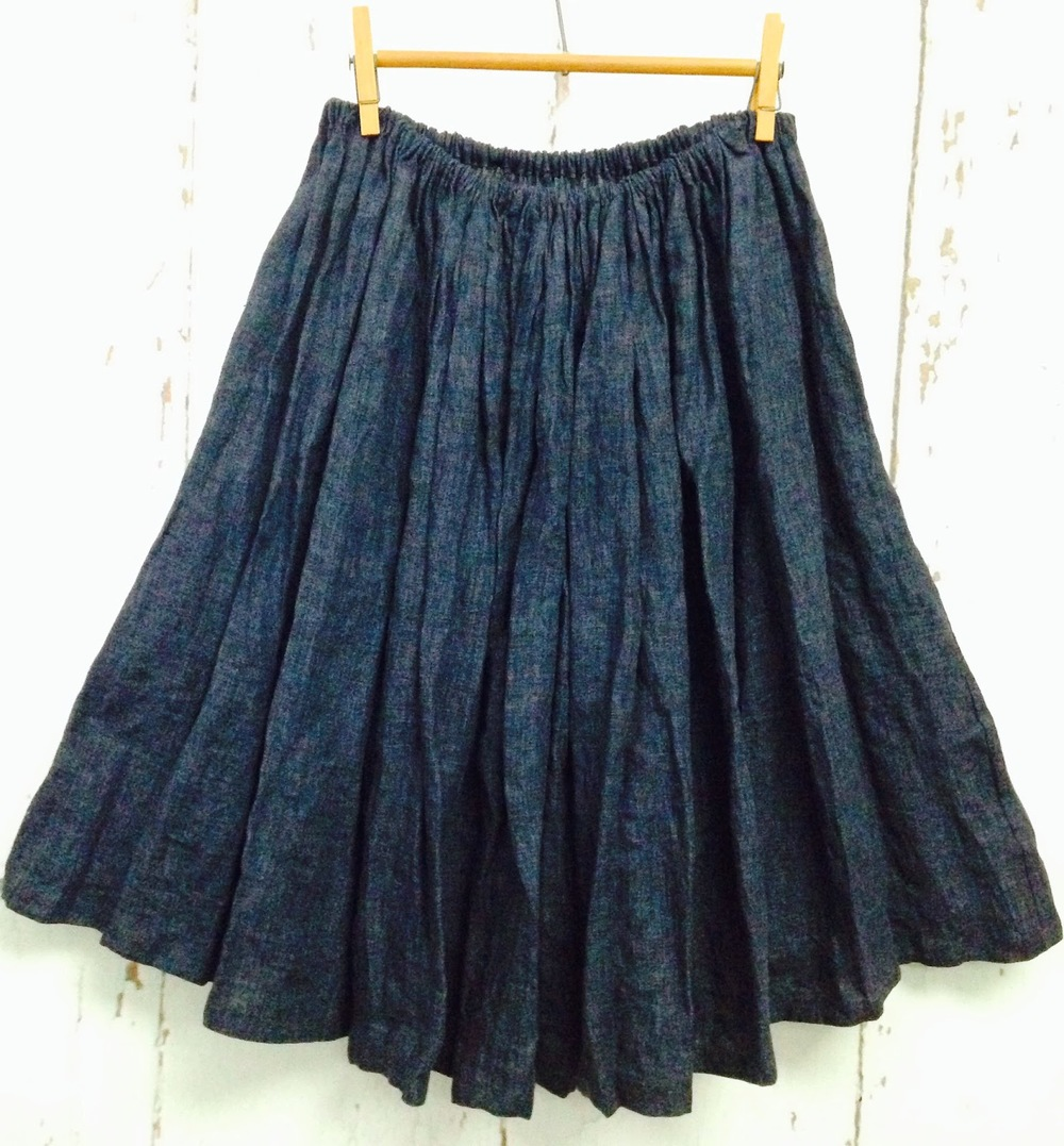 multi-gathered linen skirt with elasticized waist and two on seam pockets