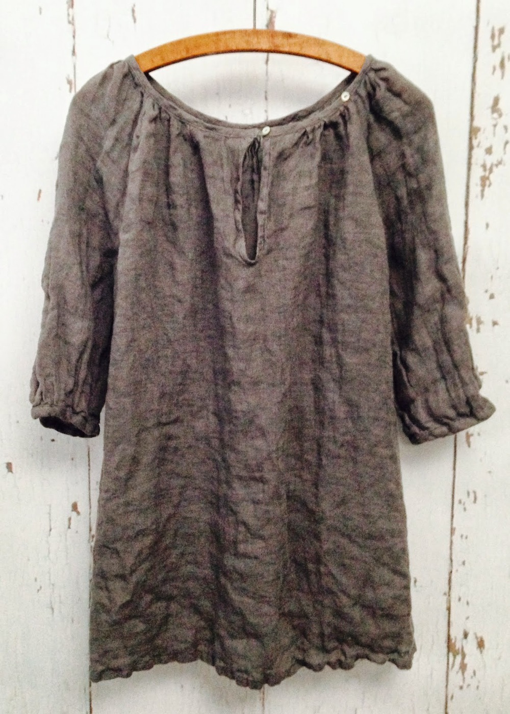 100% linen gathered tunic with two buttons at neckline for a variety of looks