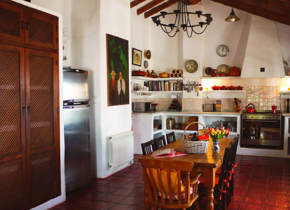 Chrome fridge freezer, microwave, toaster, dishwasher and range style cooker at wonderfully equipped Villa Amapola.