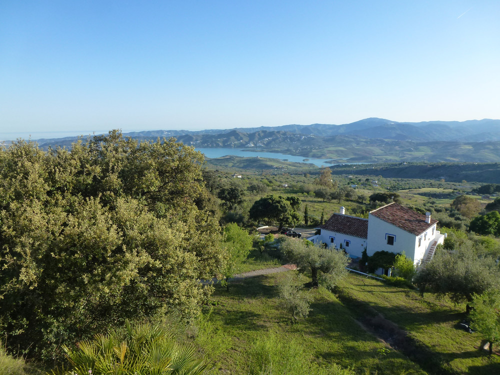 Our cortijo, situated in beautiful unspoilt countryside overlooking lake Vinuela and the mountains of the Axarquia.