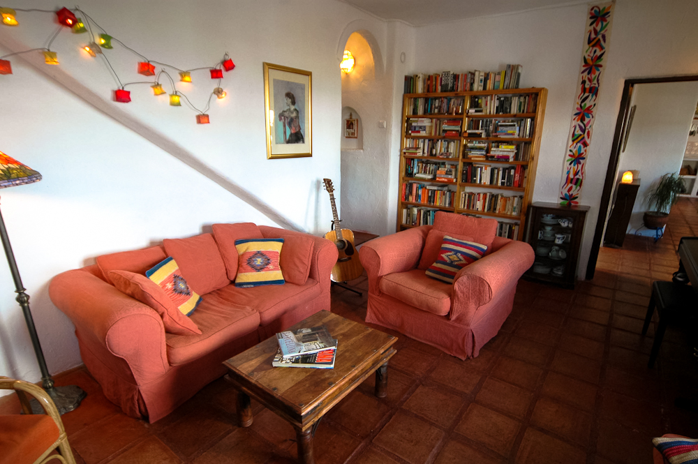 Cosy lounge with squashy sofas and extensive collection of books, music and movies at Villa Amapola.