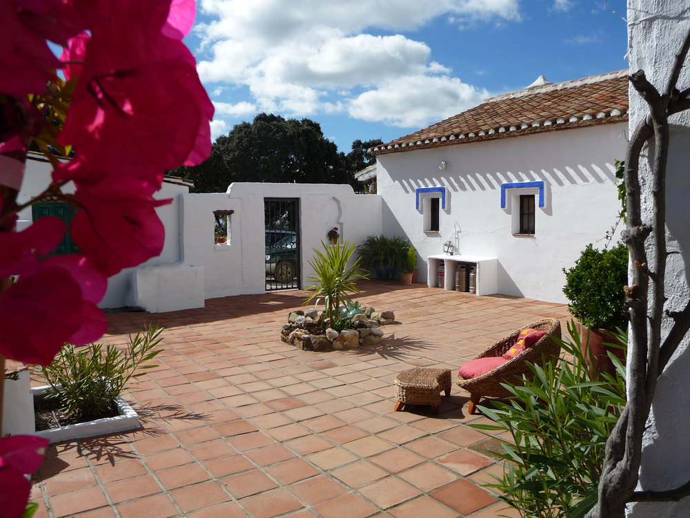 French doors lead onto a sunny enclosed terrace with typical Andalucian terracotta tiling.