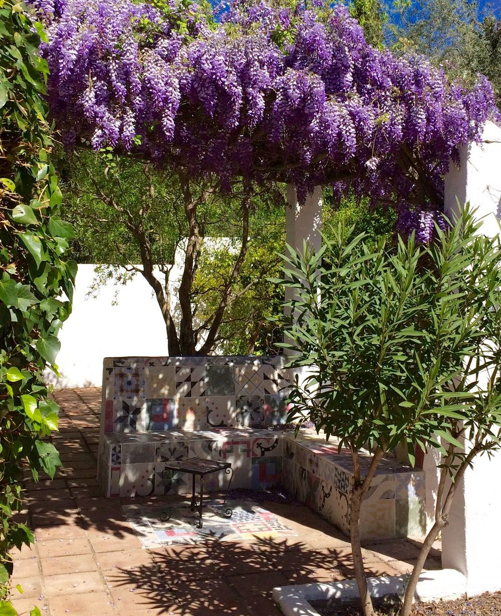 Terrace with wisteria and Andalucian Moorish ceramics.