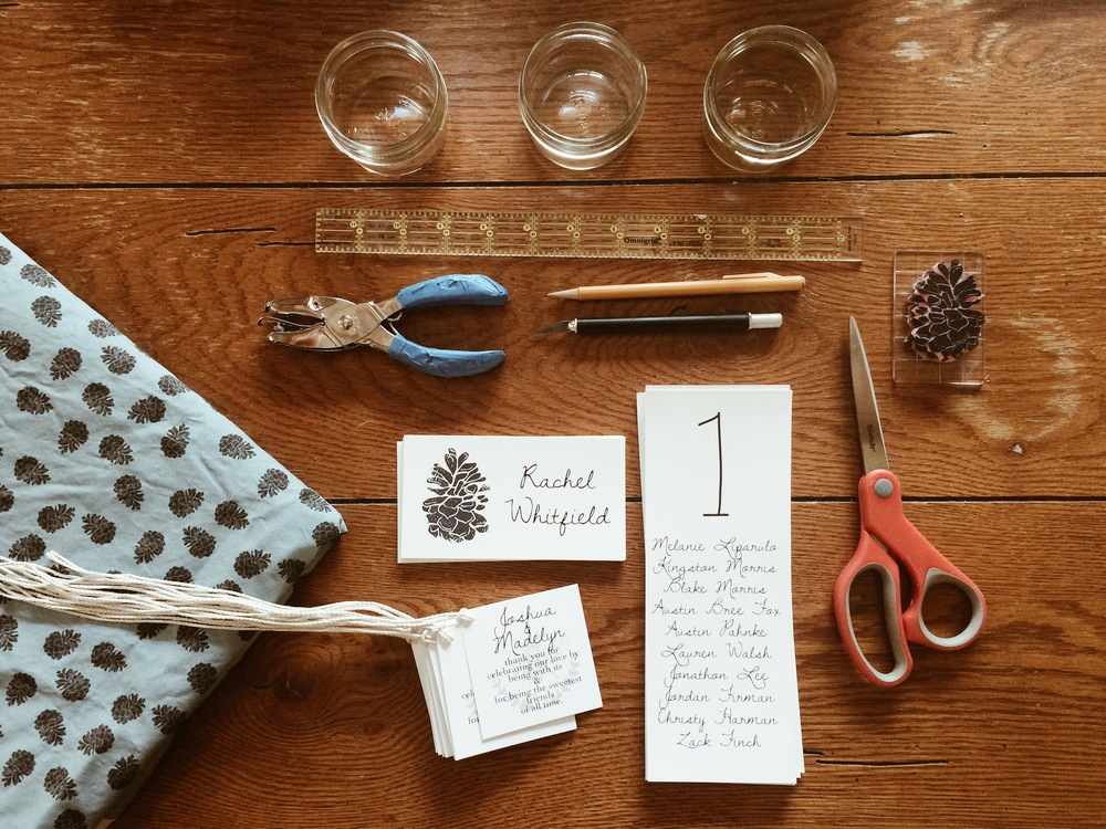 My hand carved pinecone stamp was used in several applications for the wedding.
