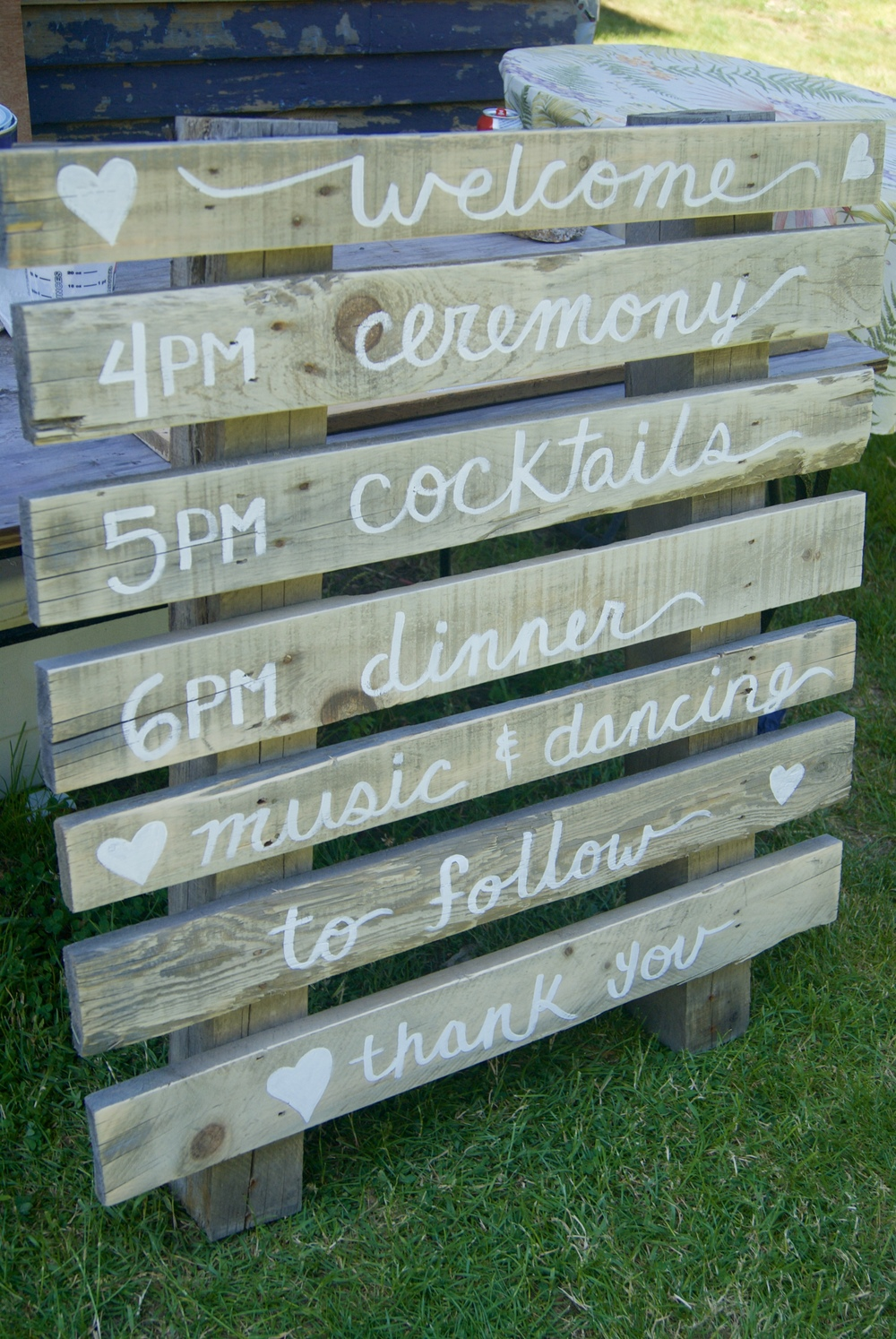 Hand painted signs for a wedding and reception on reclaimed wood.