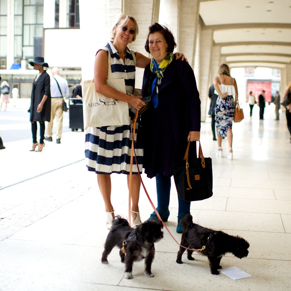 Mrs. Sizzle and Suzy Menkes taking Shinola leashes to the street.