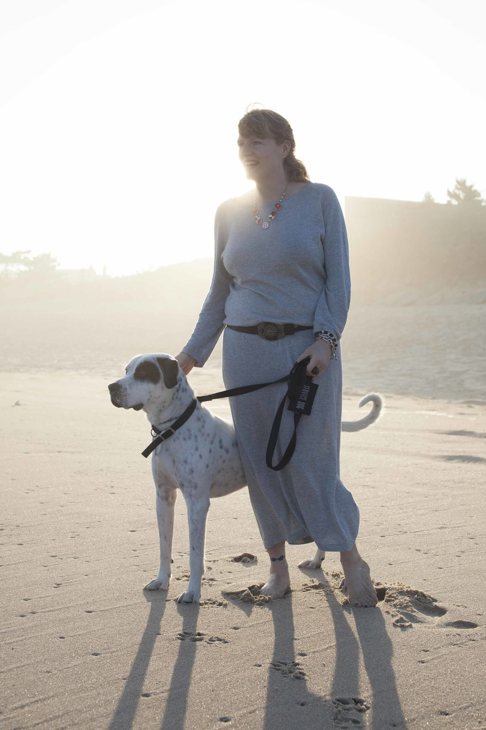 The owner, Jenny Ljungberg, on the beach with her rescue dog Gatsby who came to her from Texas Best Chance Animal Rescue. Photo by Anna Schori.