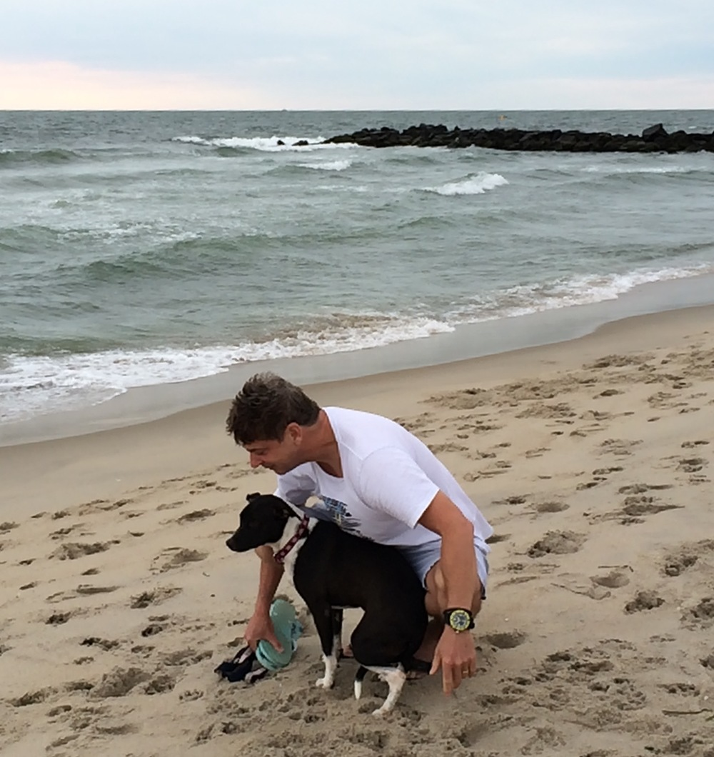 My brother Doug and Stella on the beach in New Jersey