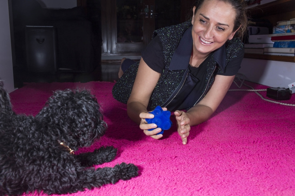 NEW YORK - JUNE 16: Faye McLeod and her dog Stella at home on June 16, 2015, in New York City. (Photo by Landon Nordeman)