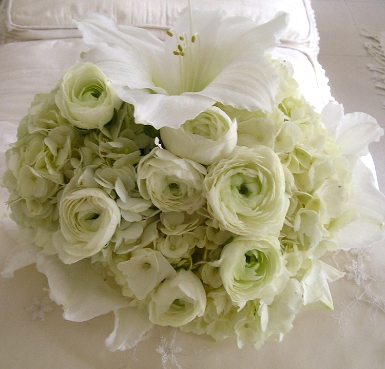 White lilies, ranunculus & hydrangea in white bouquet