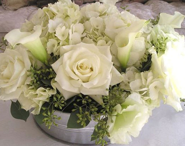 White floral arrangement in galvanized bucket
