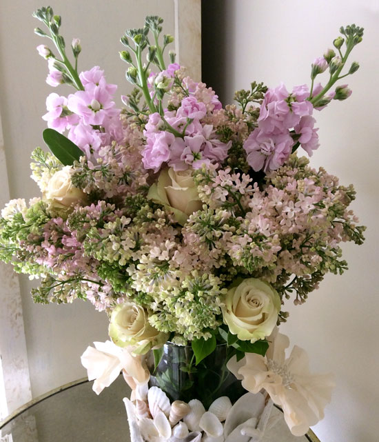 Fragrant pink spring floral arrangement with lilacs