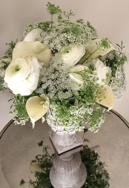 Elegant, white themed wedding centerpiece