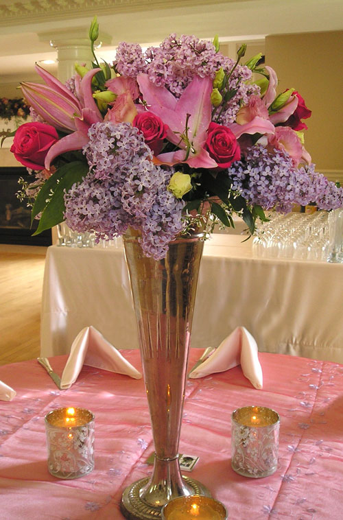Lilies, lilacs & roses centerpiece
