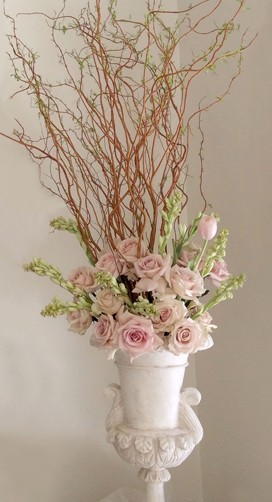 Floral arrangement with soft pinks & branches